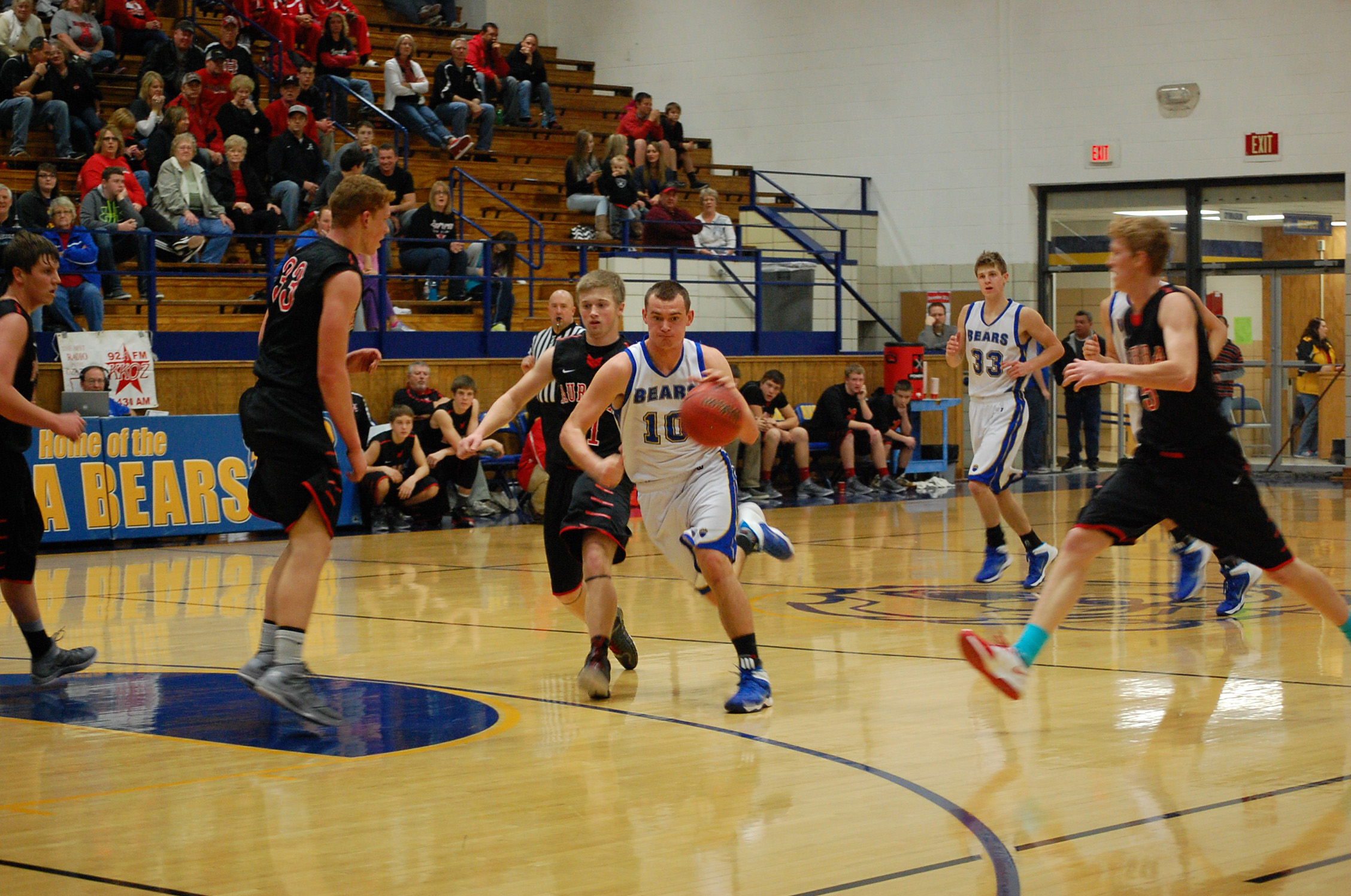 Ben Loge dribbles past an Aurora defender in the varsity game here Saturday. At far right for Ava is Brandon Guengerich (33).