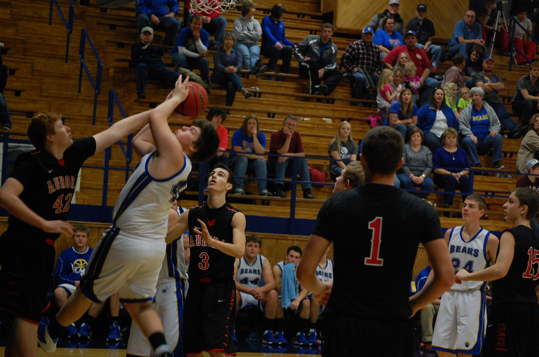 Ava's Zach Hunsaker struggles to control the ball on a rebound in varsity action Saturday with Aurora.