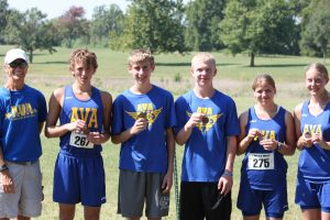 Coach Liz Kyger (left) is with her Ava cross country team at the Southwest Cross Country Coaches Association meet held on Saturday, Sept. 7, at Southwest Baptist University in Bolivar. Runners in order (from left): 4th place senior Jordan Dimirsky; 1st place sophomore Caleb Stillings; 6th place freshman Jacob Luebbering; 4th place sophomore Kayla Cooper; 10th place junior Megan Cooper. The top 10 in each division, Classes 1-4, medaled.