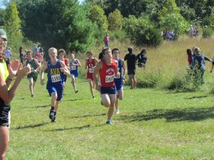 """Ava's Jacob Luebbering (1151) challenges another runner at the """"Southern Stampede"""" cross country competition on Saturday, Sept. 21."""