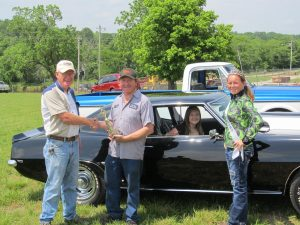 First pick in the Douglas County Fair Association's Cruise-In Classic Car Show on Saturday was Harold Lee with his 1969 Camaro. Presenting his check is Vern Deatherage (left). At right is 2013 Fair Princess Dallee Sheppard.