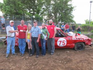 Winners of the Douglas County Fair Association's demolition derby Saturday night were Austin Roberts and Brad Philpott. Presenting the check at left is Vern Deatherage. Also pictured are Summer Fest Queen Kaylin Drenske, Prince Trevor McChesney and 2013 Fair Princess Dallee Sheppard.
