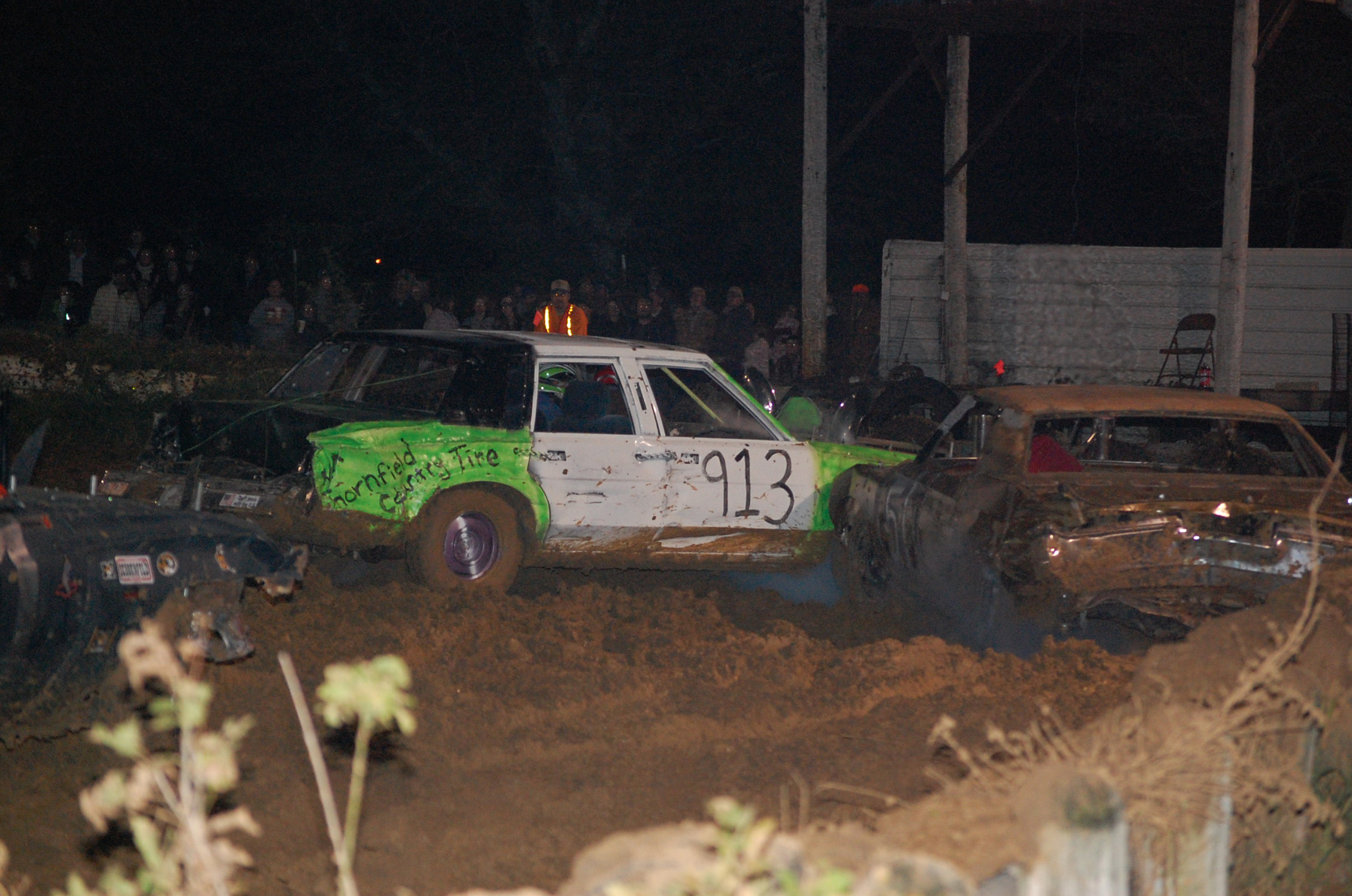 Demolition derby cars mix it up in a preliminary heat race at the Douglas County Fairgrounds last Saturday night.