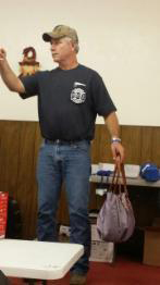 Mark with his purse at the EDCVFD fundraiser auction.