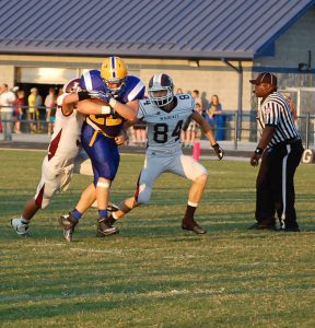 Chase Willis, who rushed for 130 yards against Rogersville last Friday night, takes care of the ball on this run.