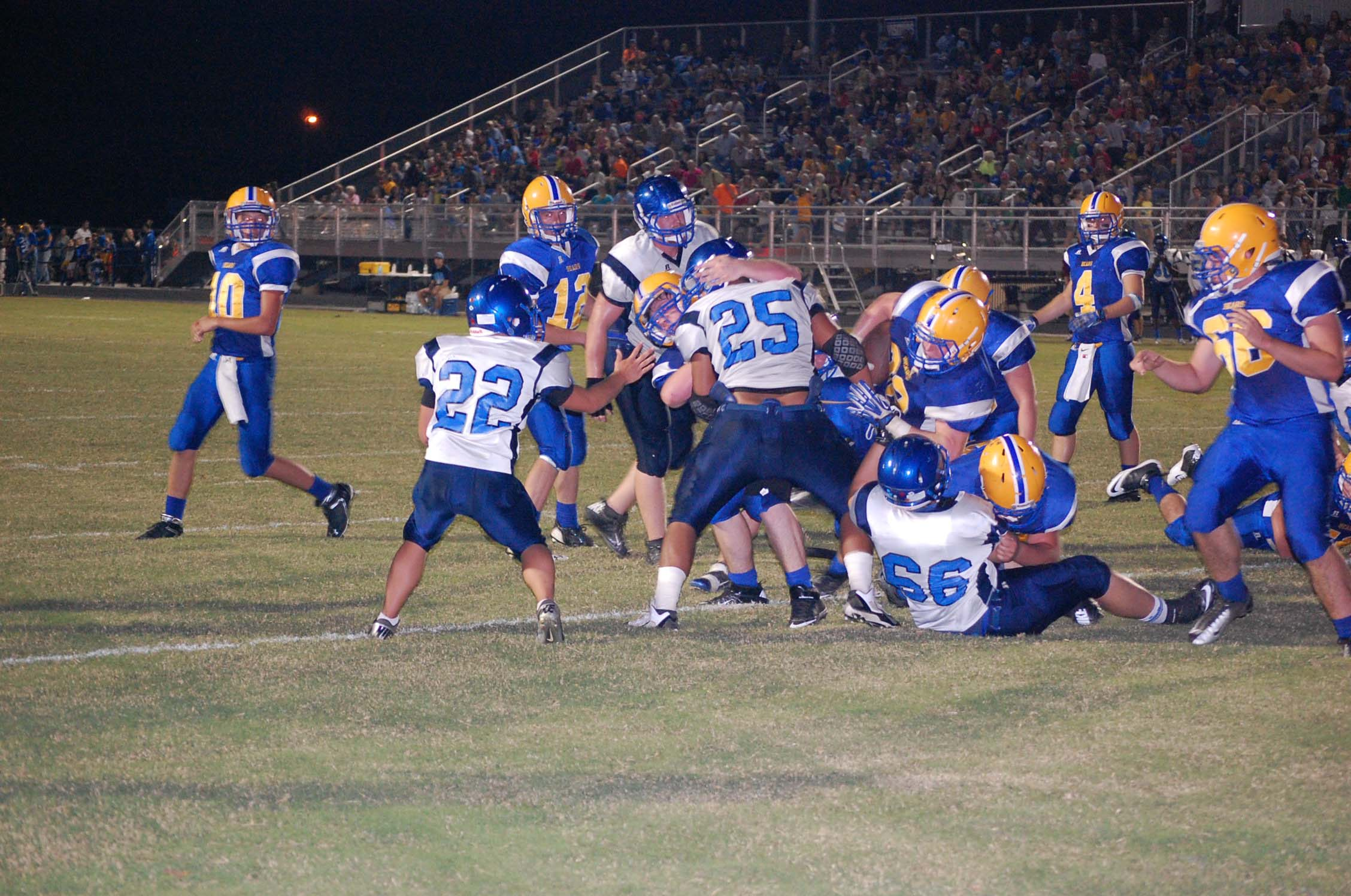 Chase Willis goes up the middle for one of his three touchdowns last Friday night in Ava's 44-7 SCA win over Salem.