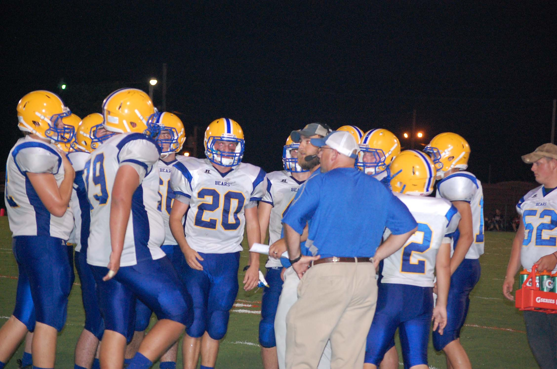 Ava's head coach Dan Swofford and offensive coordinator Casey Merrifield talk things over on the sideline with the Bears during a water break Friday night. The start of the game was backed off till 7:30 because of the heat, but it was still 90 degrees when the game ended just before 10 p.m.