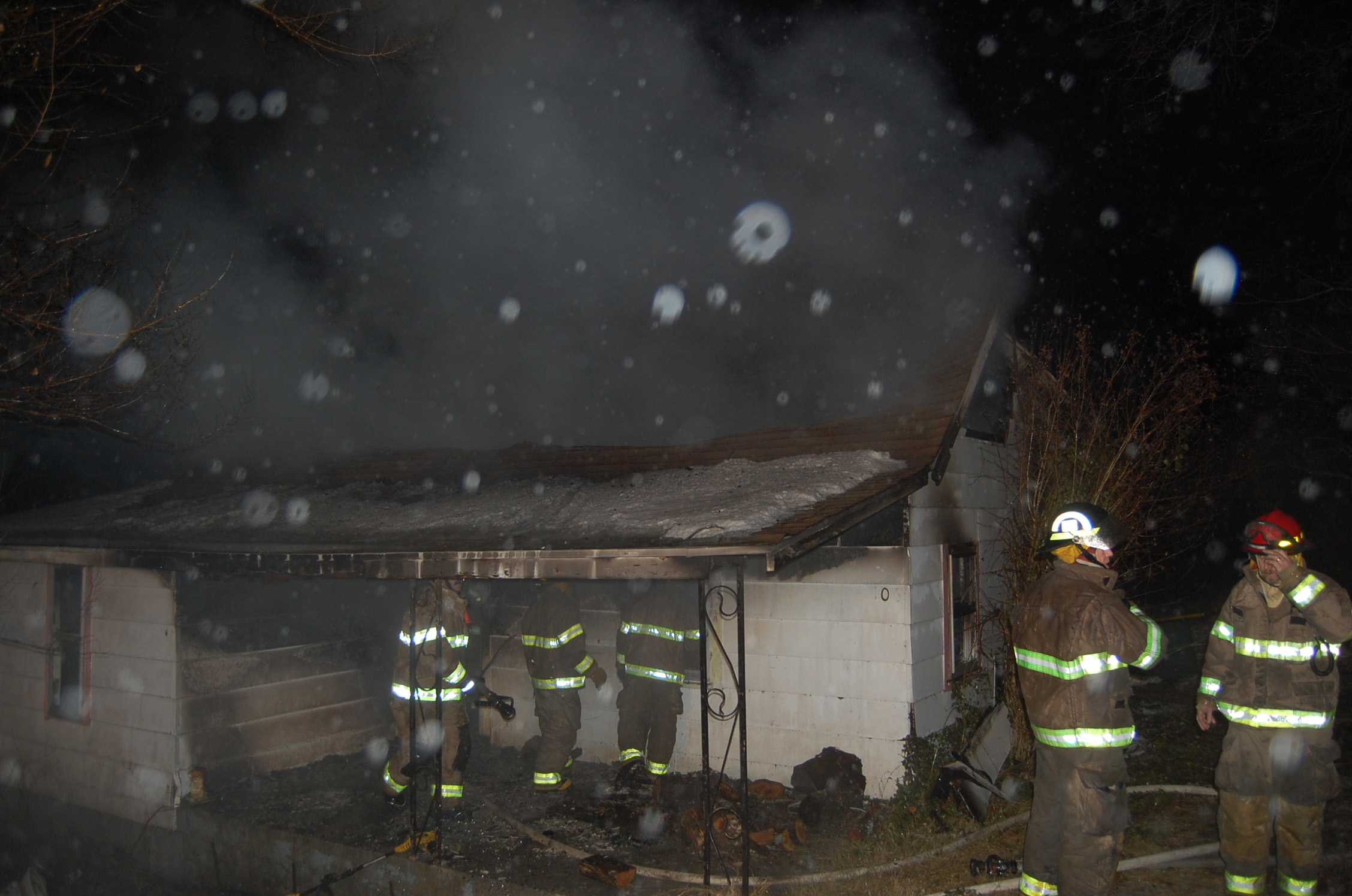 Firemen from the City of Ava and Ava Rural Fire departments battled freezing rain and snow, as well as fire, at this house fire in east Ava last Friday night.