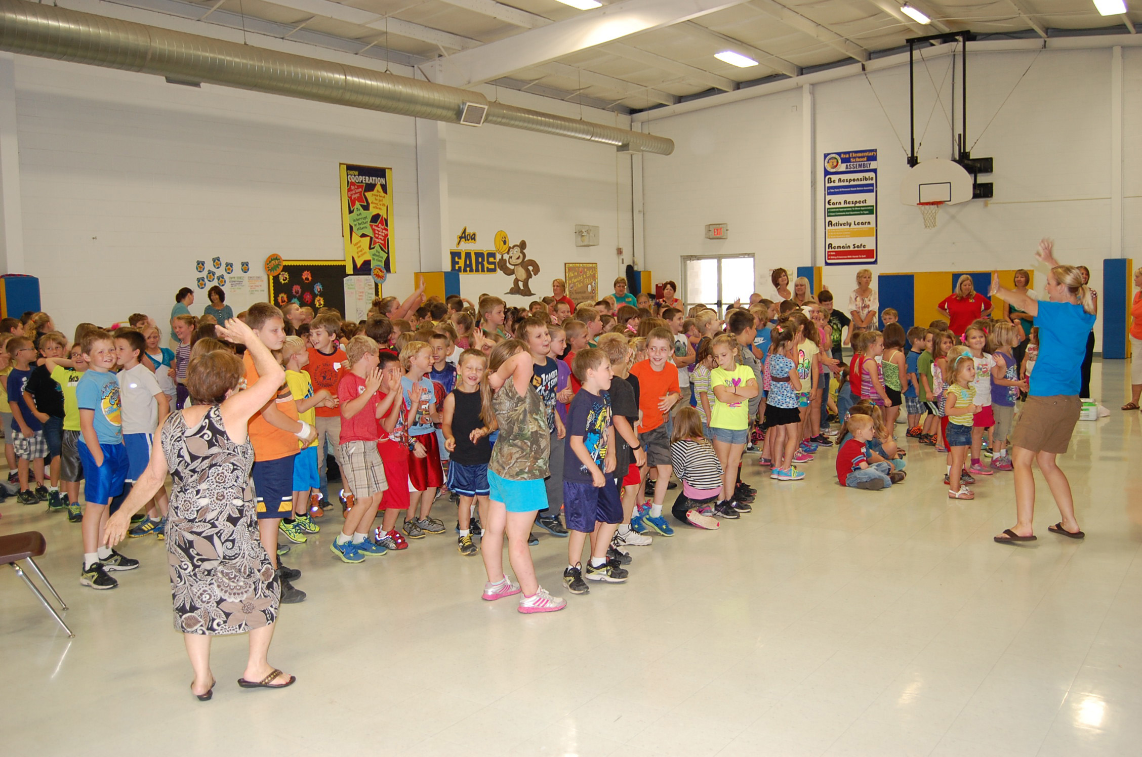 Ava Elementary teacher Susan Trowbridge (left) and Rebecca Smith (right), with University of Missouri Douglas County Extension, lead students in a brisk dance exercise during the Food Power program on Sept. 19.