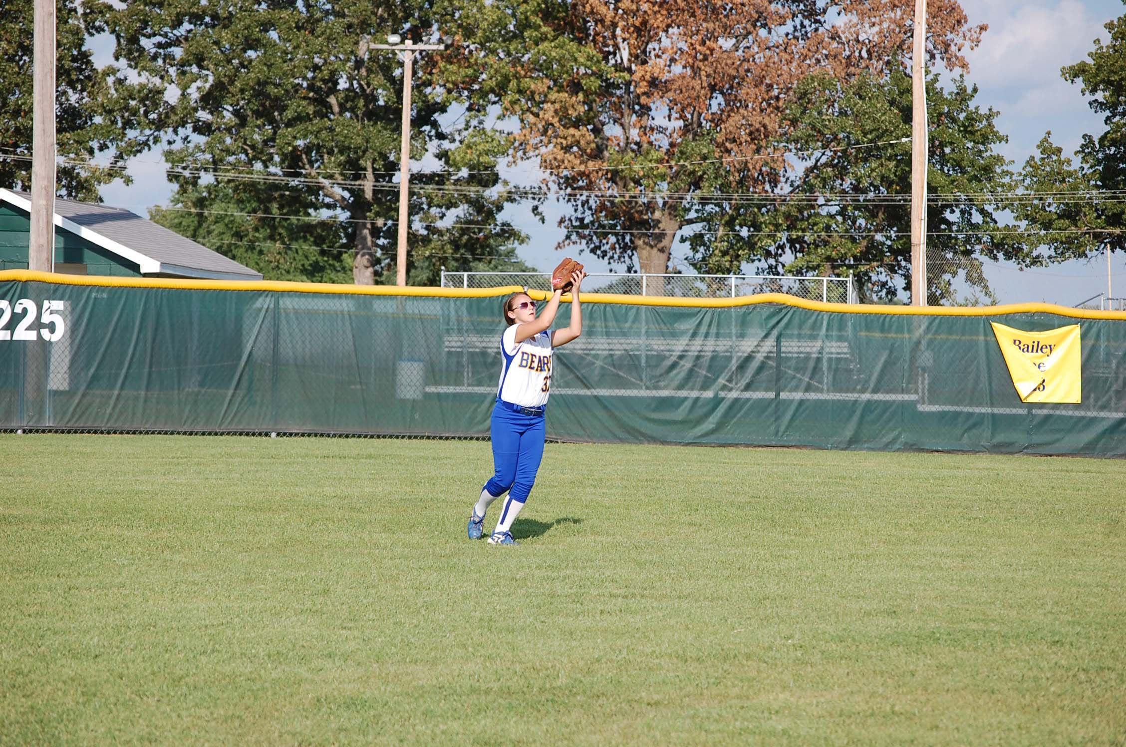 Junior Callie Eubanks squeezes the ball for the sure out on a pop fly to center field in the Dora game here last Thursday.