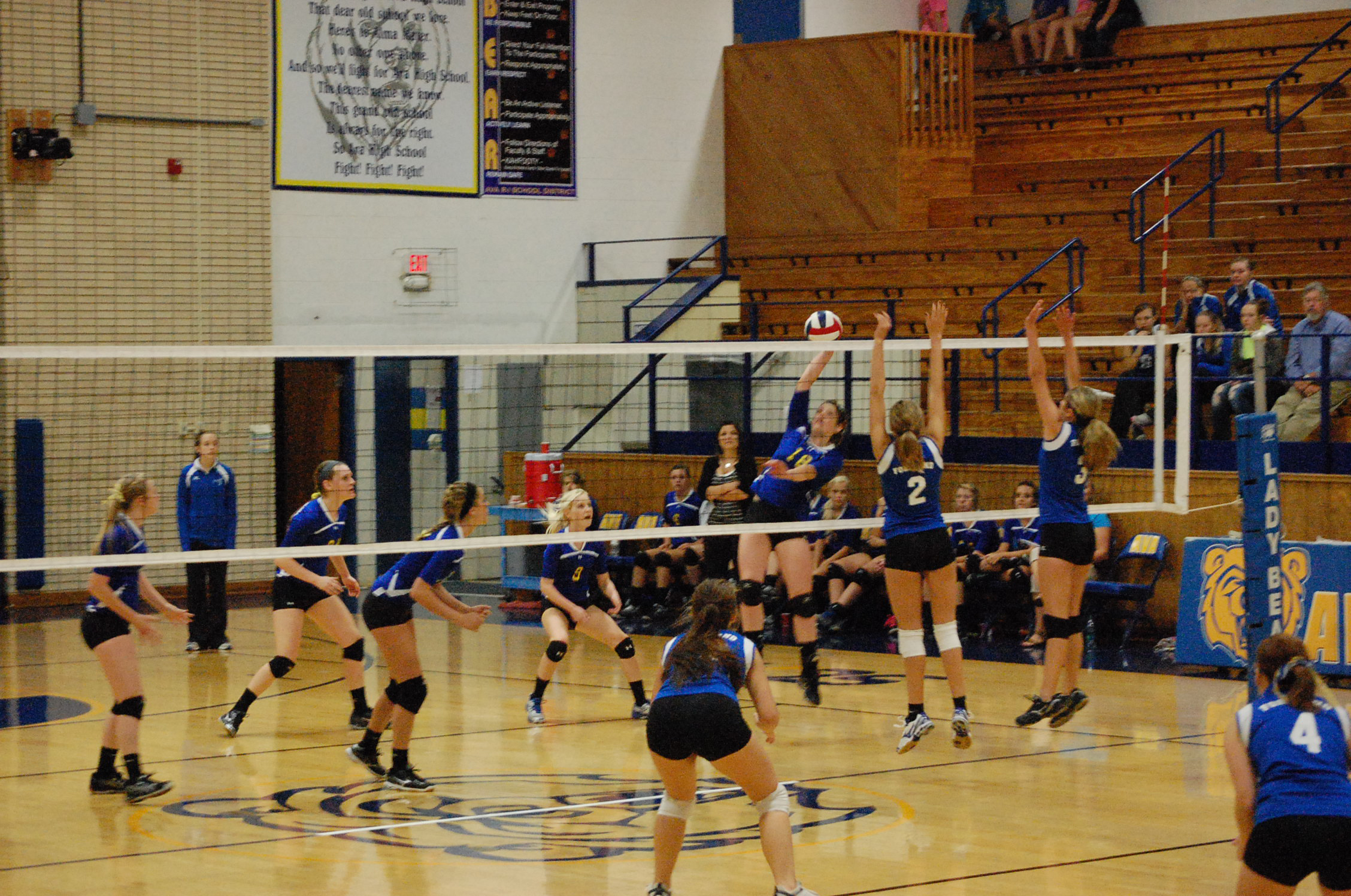 Alena Stokes hits the ball over the net in volleyball action against Fordland Monday night.
