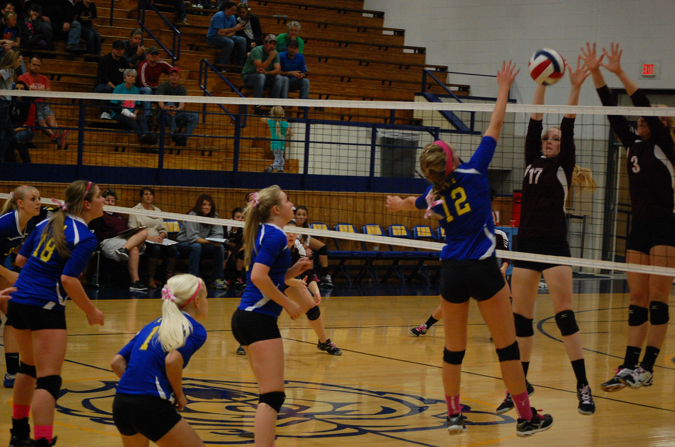 Ava's Rachel Swofford (12) and Mtn. Grove's Malissa Emmerson battle at the net in volleyball action here Tuesday.