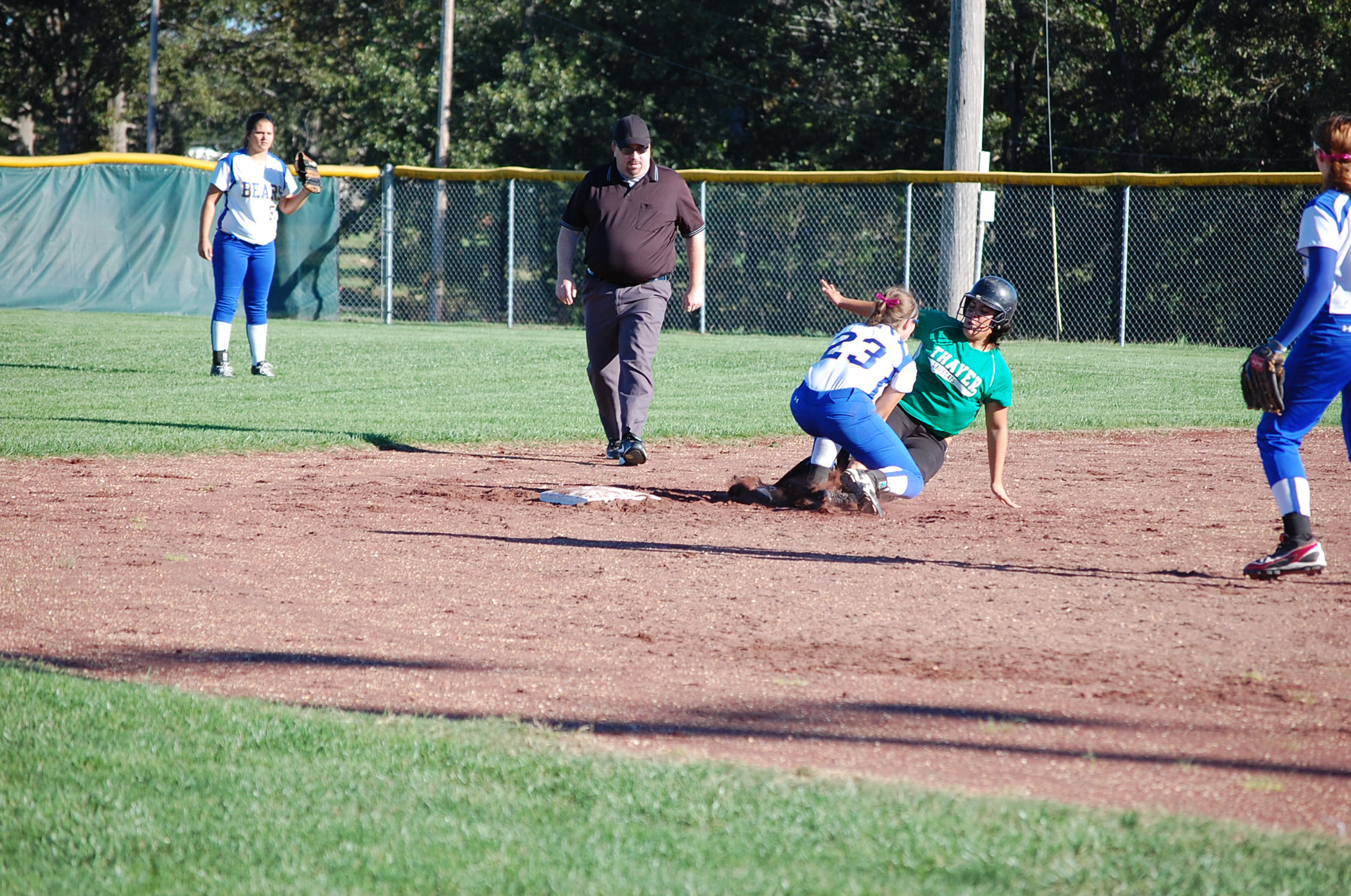 Ava second baseman Bailey Lee puts the tag on a Thayer player stealing second here Monday.