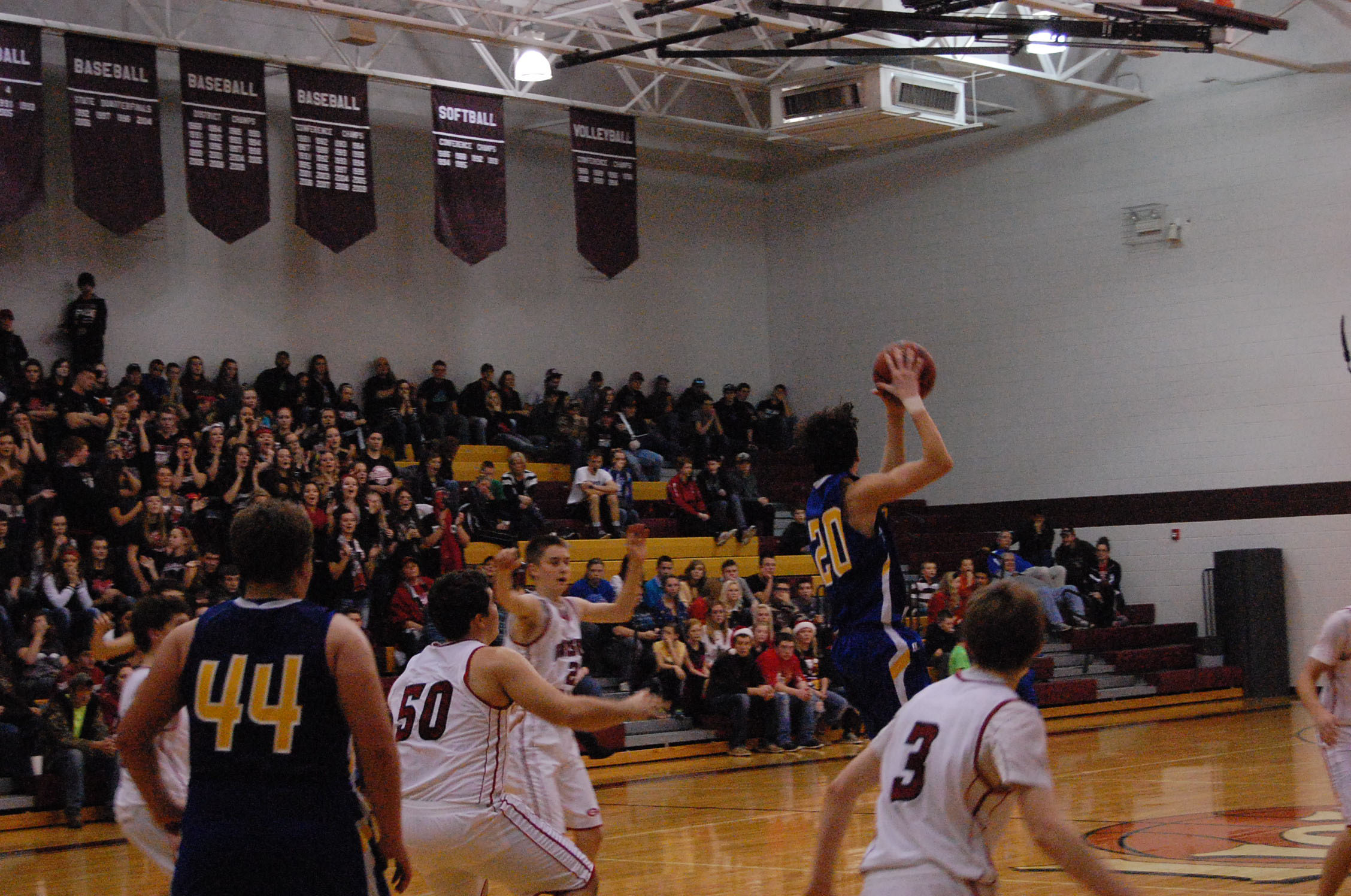 Ava freshman Anthony Rosa leaps high to receive a pass against Gainesville Saturday night in the Mansfield Tournament.