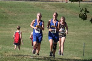 Sophomores Hayden Schuster (left) and Sage Clunn at SWCCCA meet in Bolivar last Saturday.