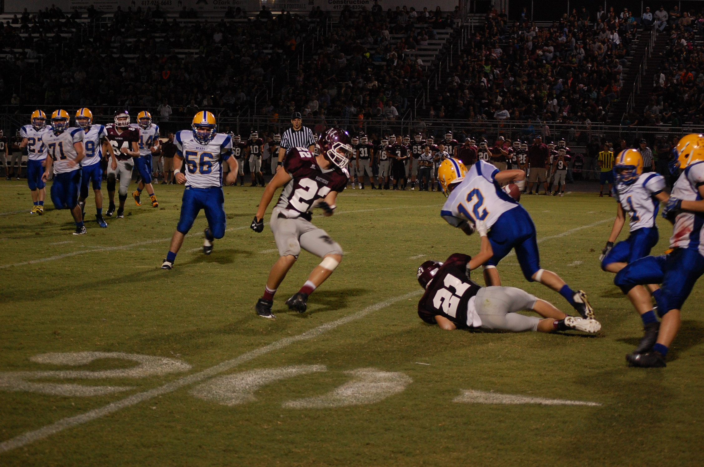Mtn. Grove's Jamison Cain grabs a handful of jersey as he attempts to bring Kane Thompson down after Thompson intercepted a Mtn. Grove pass in the first half Friday night.