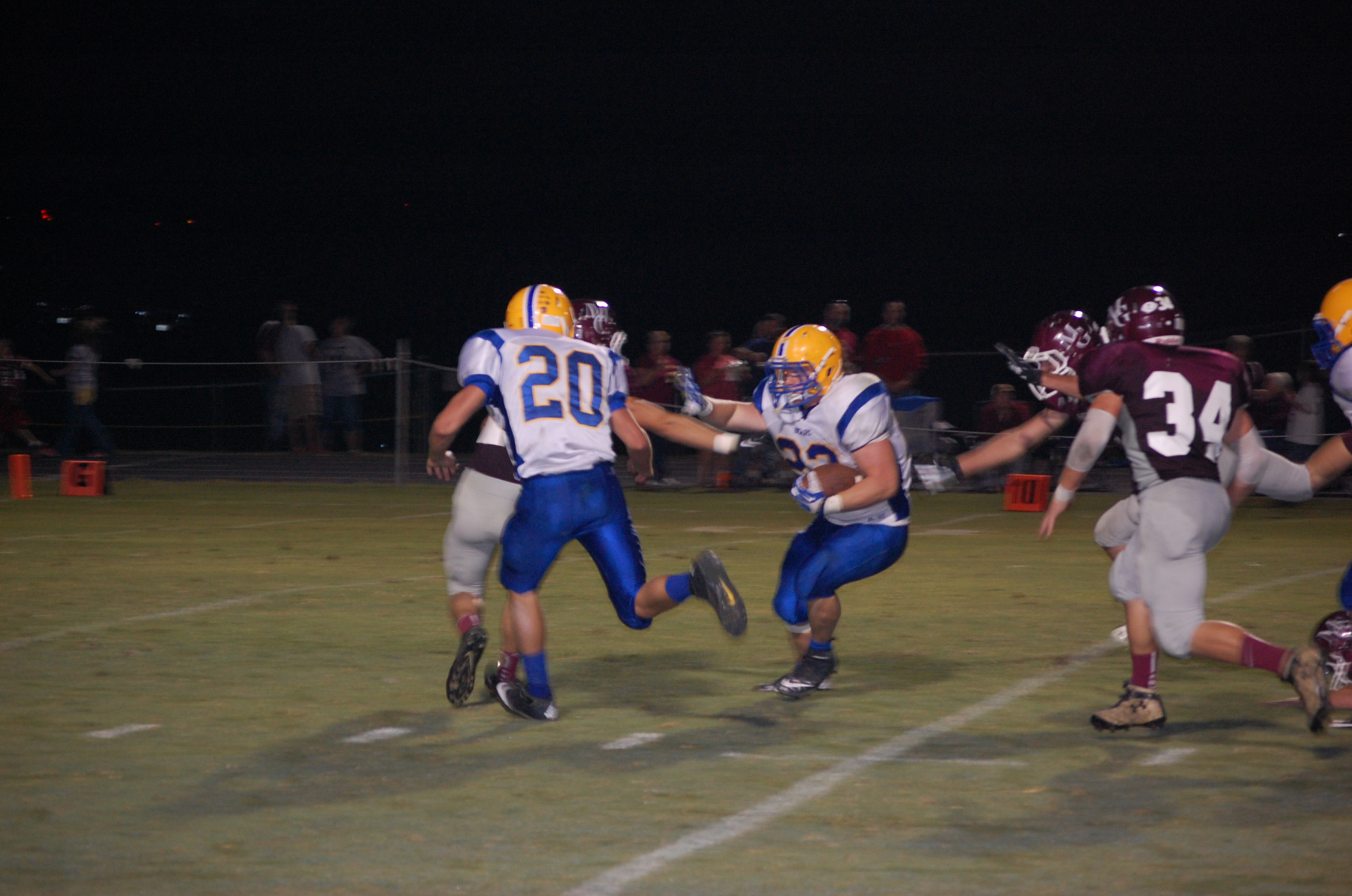 Chase Willis was Ava's leading rusher at Mtn. Grove with 83 yards on 11 carries, including this one on Ava's third-quarter scoring drive. Jesse Dean (20) moves in to throw a block for the ball carrier.