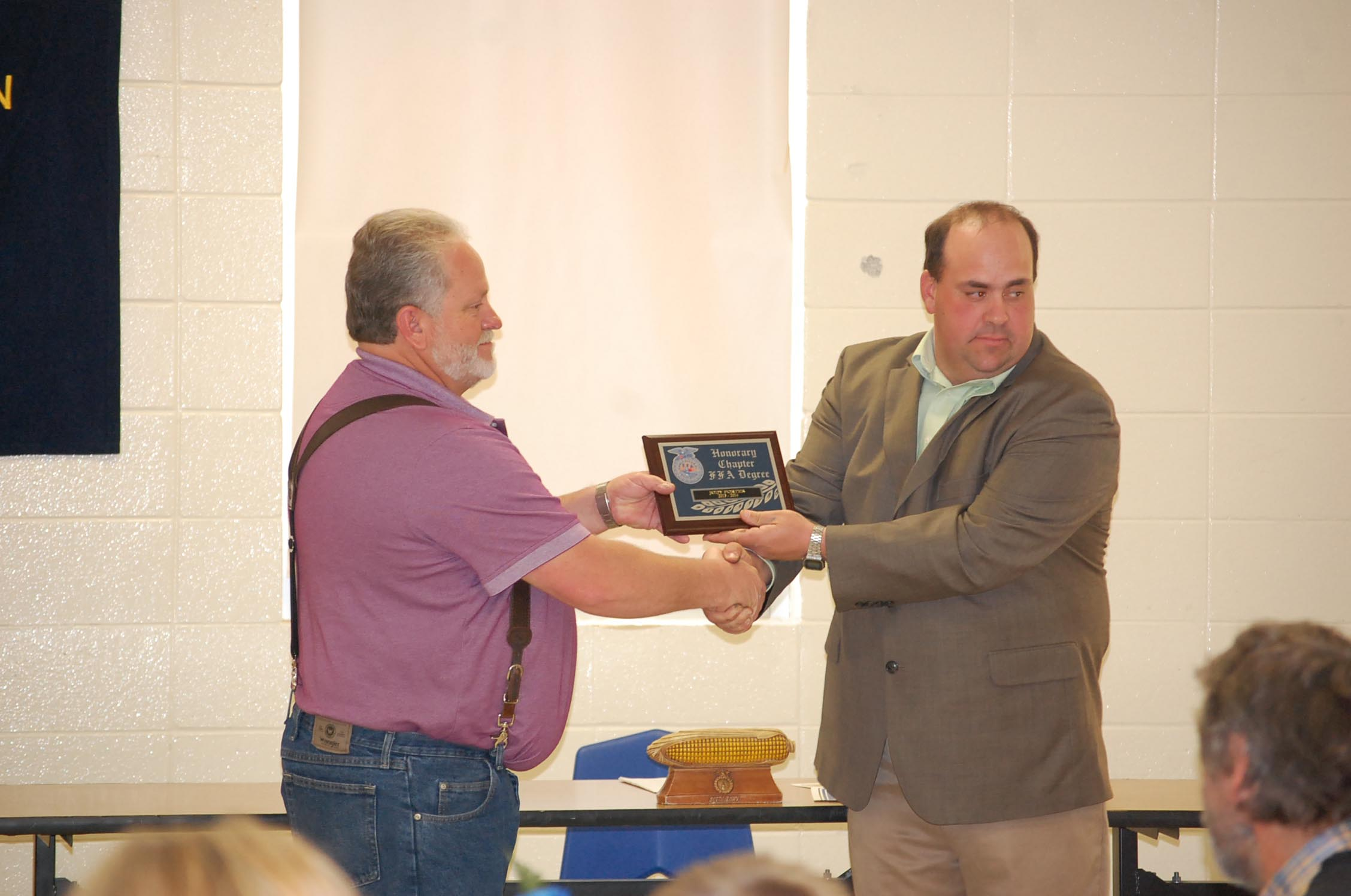 FFA Advisor Brent Lakey (right) presents the Honorary Chapter Degree to Jody Porter, advertising manager of the Douglas County Herald, at the annual FFA Banquet last Friday night.