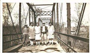 Rome bridge Ralph & Russell Mackey and girls on Rome Bridge - Cotton Gin Building