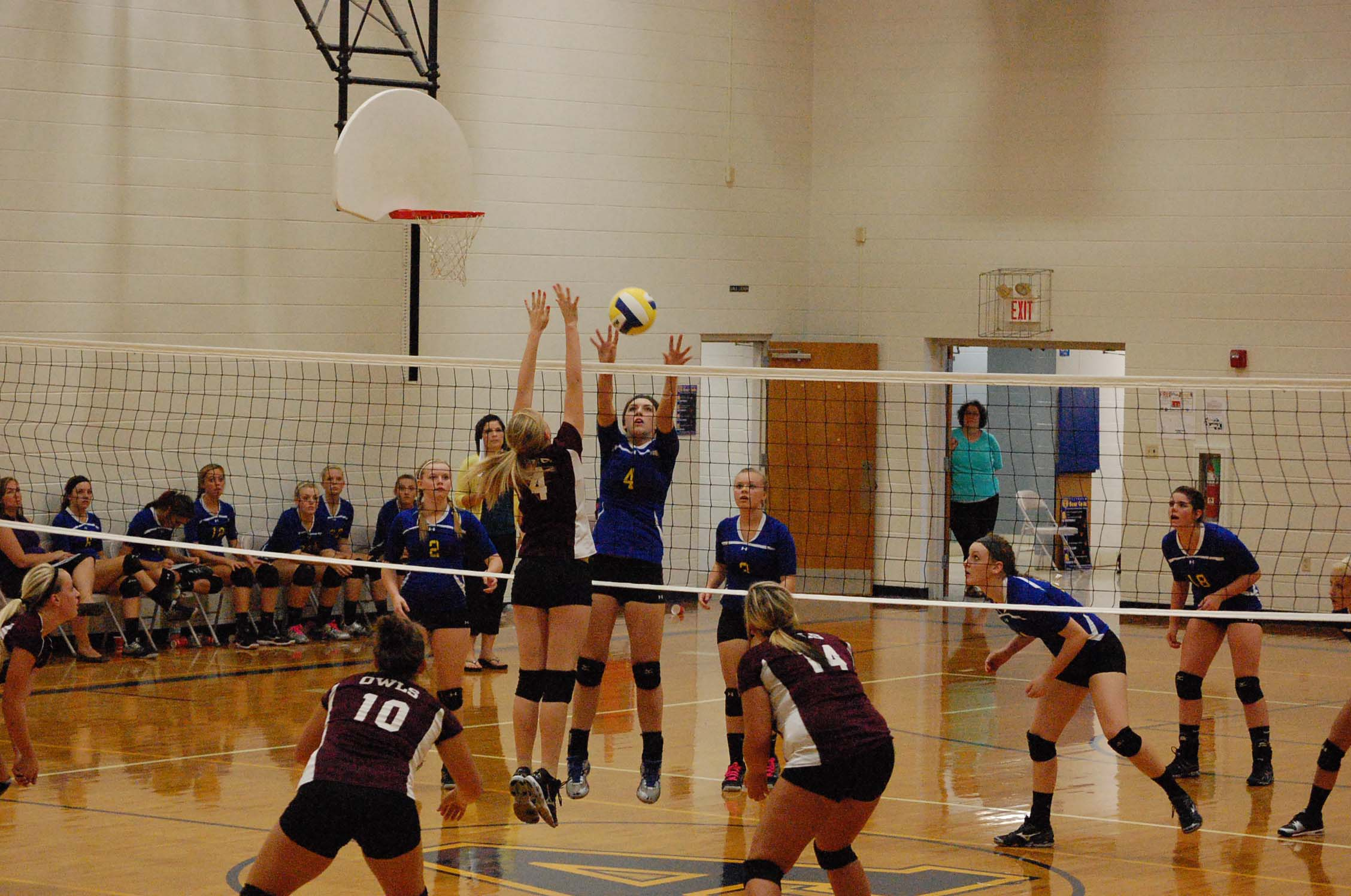 Erica Croney successfully returns the ball against Spokane in action here last Thursday night.
