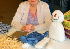 Doug Berger/Herald Regina Robertson with parts and patterns for creation of snowman.